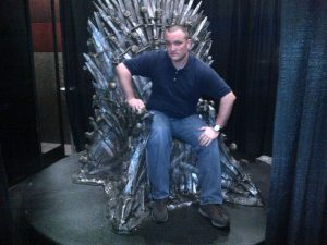 """Ryan Alford sitting on the """"Throne of Swords"""" at the 2013 SXSWi."""